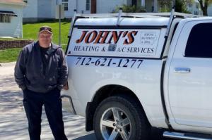 John standing next to truck